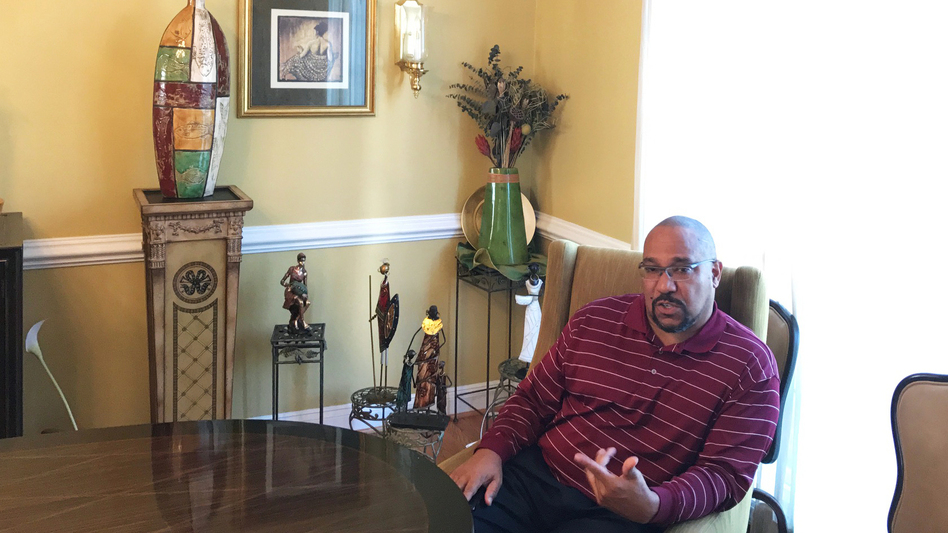Phillip Thompson is a Gulf War veteran and a lawyer with his own practice. When he moved to his exclusive Leesburg, Va., enclave more than a decade ago, many of his mostly white neighbors assumed he had to be a professional athlete to afford his home. (Brakkton Booker/NPR)