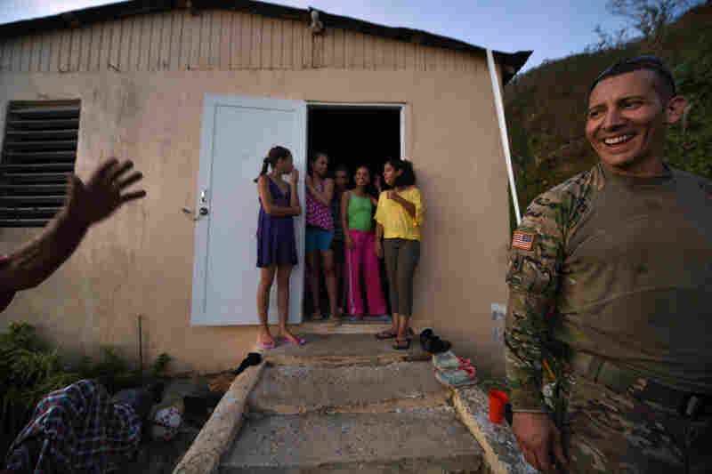 Caraballos thanks Santini as his wife and daughters stand in the doorway.