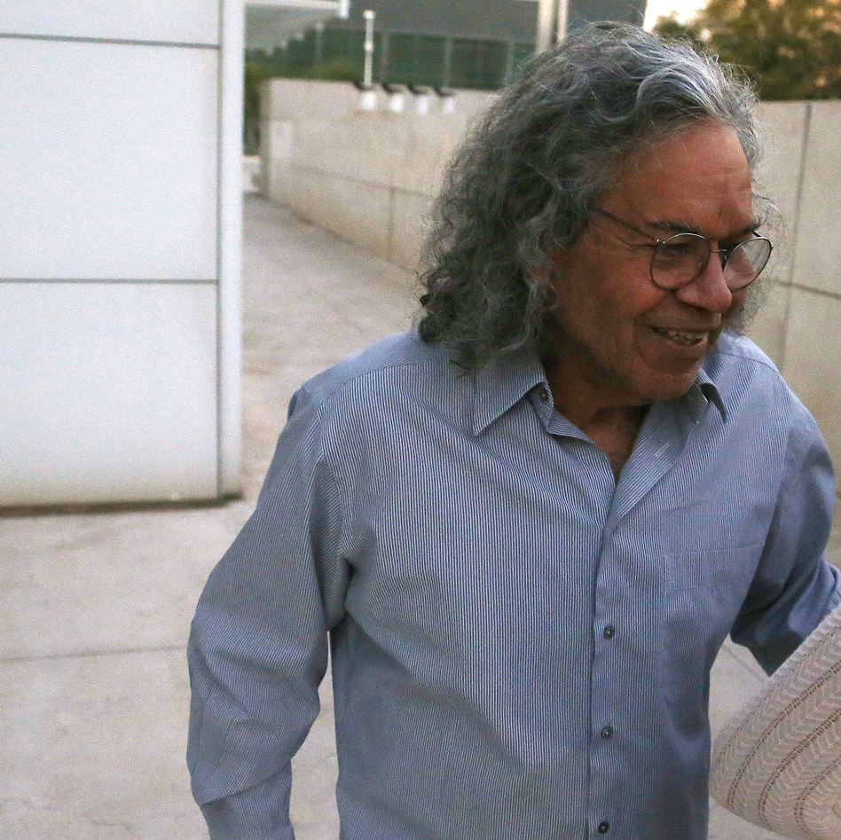 Billionaire founder of Insys Therapeutics John Kapoor leaves U.S. District Court after being arrested earlier Thursday in Phoenix. Kapoor and other defendants in the fraud and racketeering case are accused of offering bribes to doctors to write large numbers of prescriptions for a fentanyl-based pain medication meant only for cancer patients with severe pain. (Ross D. Franklin/AP)