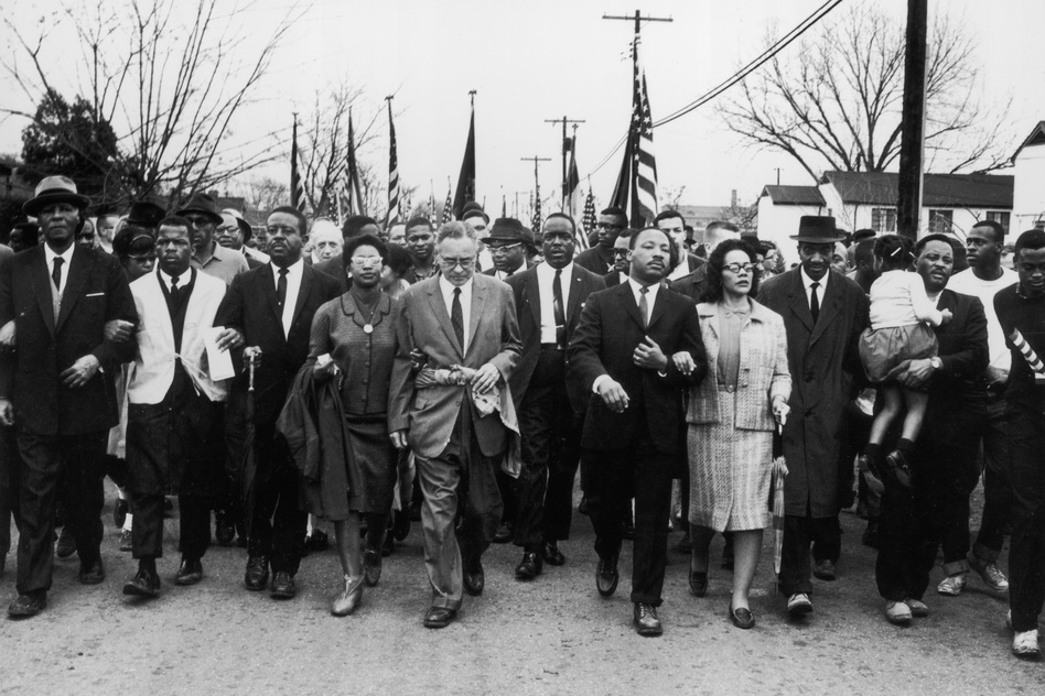 Civil rights leader Rev. Martin Luther King Jr. and his wife Coretta Scott King lead a black voting rights march from Selma, Ala., to the state capital in Montgomery in 1965.