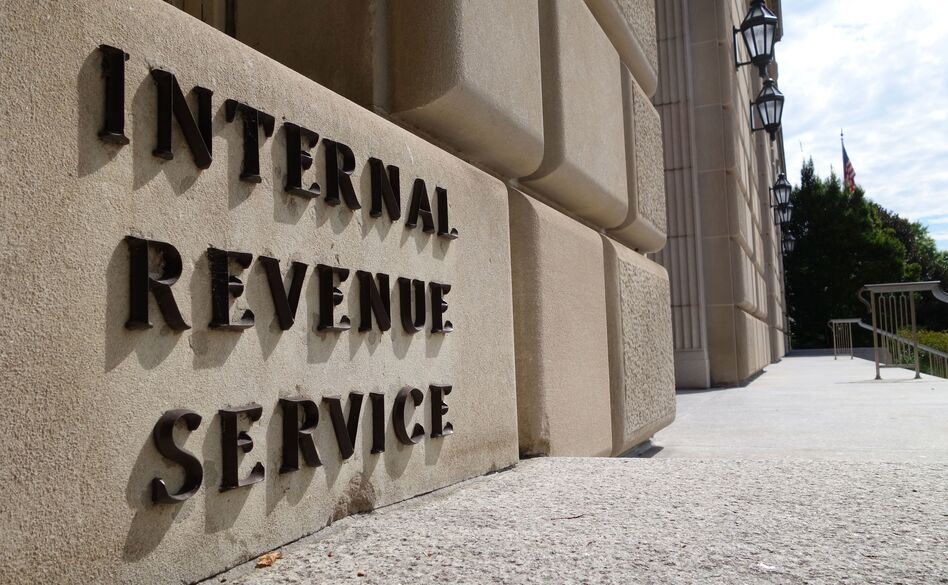 The Justice Department has entered settlements for two cases related to IRS scrutiny of groups seeking tax-exempt status. (Karen Bleier/AFP/Getty Images)