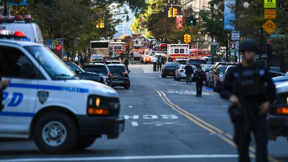 """Police secure the area in Lower Manhattan near where a vehicle drove onto a bicycle path Tuesday afternoon, killing """"several people,"""" according to New York City police. (Don Emmert/AFP/Getty Images)"""