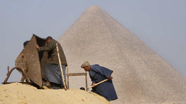 Archaeology workers toil in front of the Great Pyramid, in Giza, Egypt, in 2010. Researchers say they