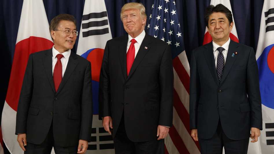 President Trump meets with Japanese Prime Minister Shinzo Abe (right) and South Korean President Moon Jae-in before the Northeast Asia Security dinner at the U.S. Consulate General in Hamburg, Germany, on July 6. (Evan Vucci/AP)