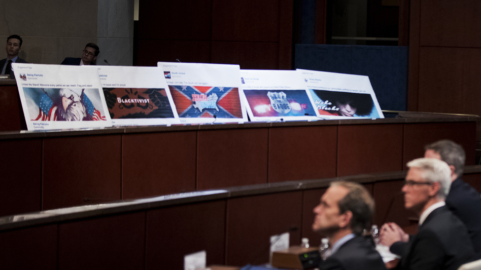 Facebook ads linked to a Russian effort to disrupt the American political process are displayed as, from left, Google's Kent Walker, Facebook's Colin Stretch and Twitter's Sean Edgett, testify during a House Intelligence Committee hearing on Wednesday, Nov. 1, 2017. (Manuel Balce Ceneta/AP)