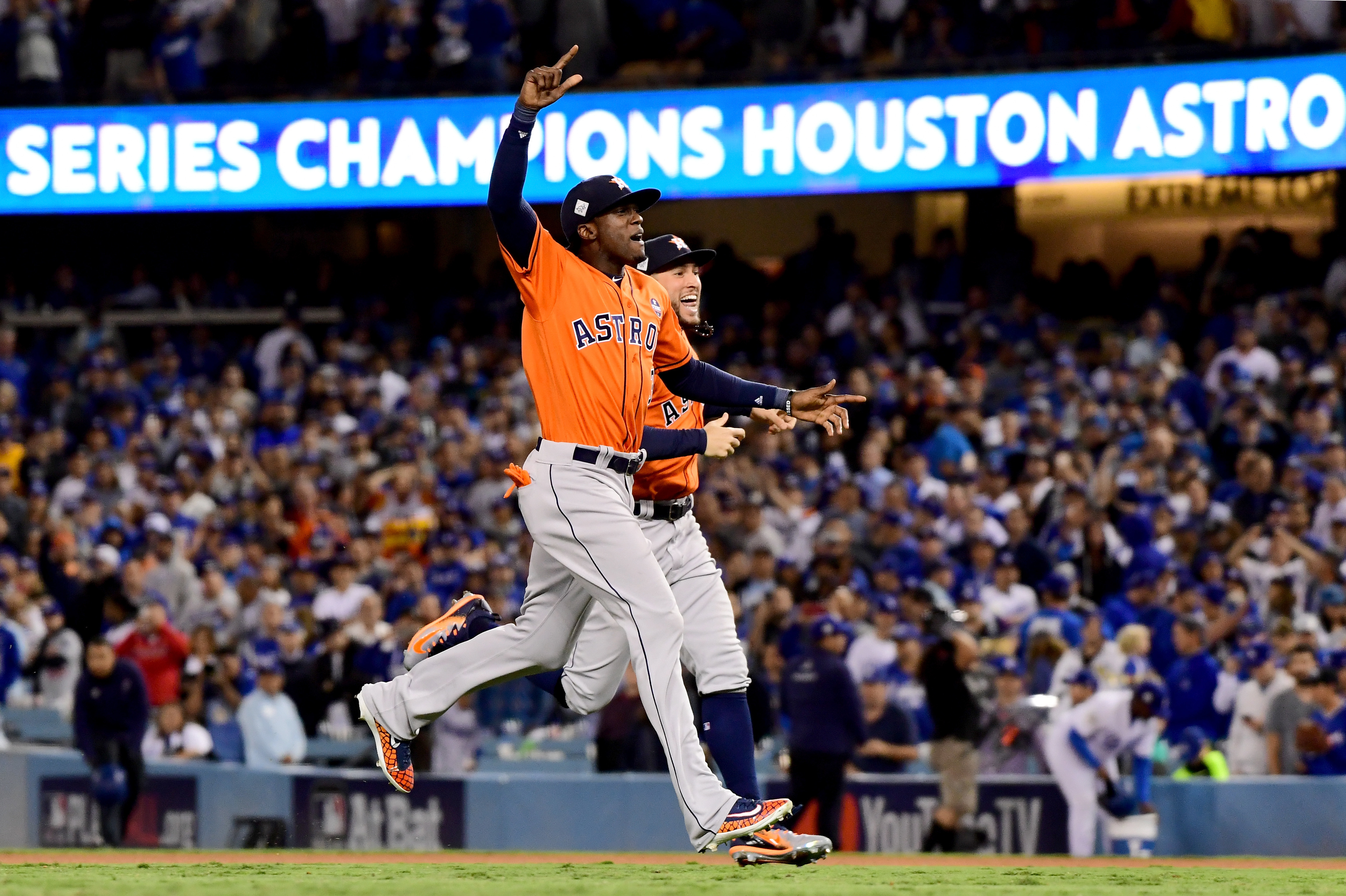Cameron Maybin and George Springer of the Houston Astros celebrate after winning the team's first World Series title.