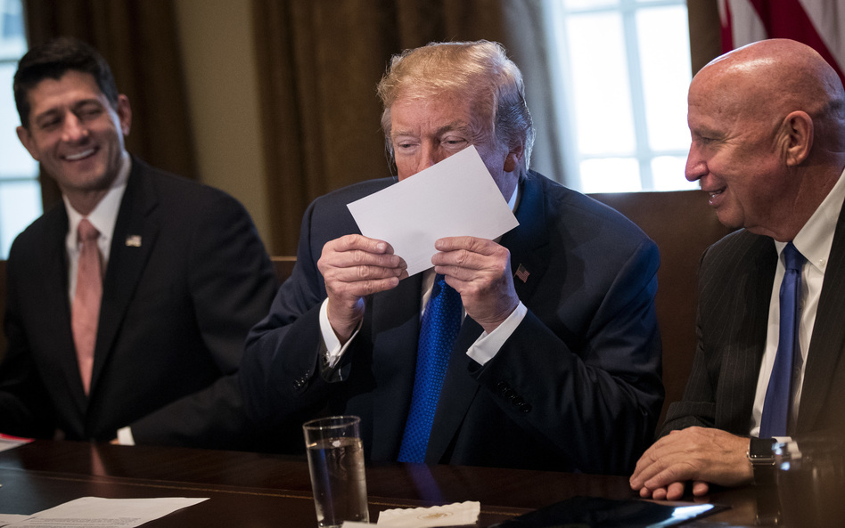 President Trump holds a sample of the Republicans' proposed postcard-size tax return. (Drew Angerer/Getty Images)