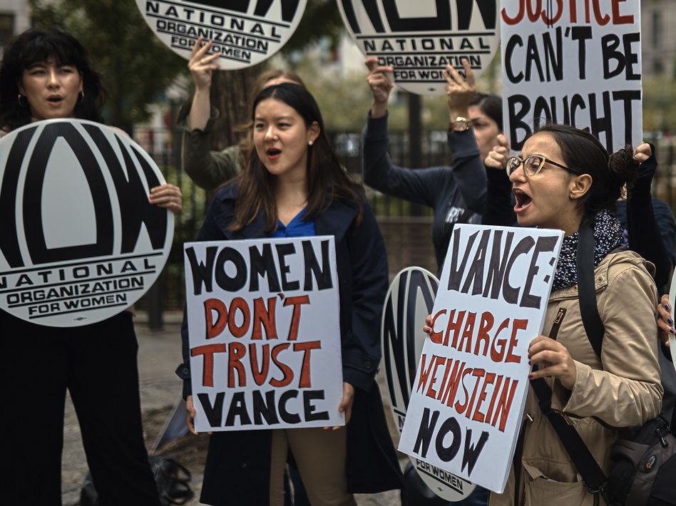 A group gathered outside the Manhattan District Attorney's office on Oct. 13 protests the DA's decision not to prosecute Harvey Weinstein in connection with a 2015 incident involving a model. (Andres Kudacki/AP)