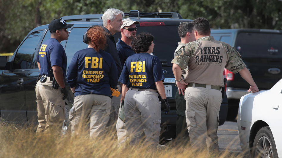 Law enforcement officials continue their investigation at the First Baptist Church of Sutherland Springs in Texas on Monday. (Scott Olson/Getty Images)