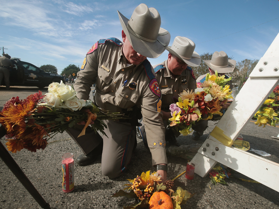 Police move flowers placed at a barricade near the First Baptist Church of Sutherland Springs on Monday in Sutherland Springs, Texas. (Scott Olson/Getty Images)