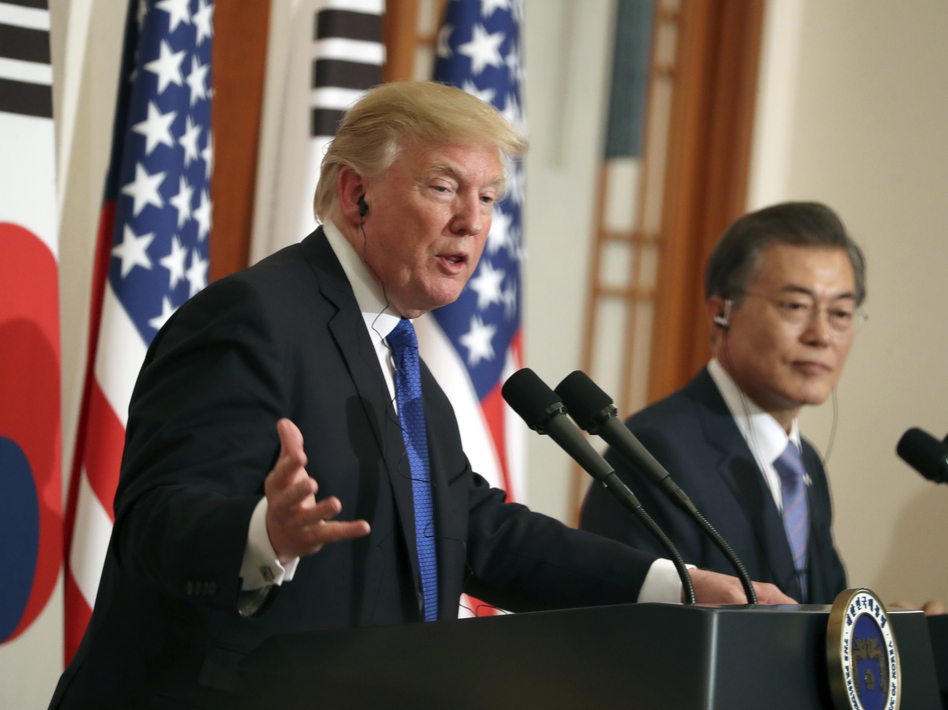 President Trump speaks as South Korean President Moon Jae-in looks on in a joint news conference at the Blue House in Seoul, South Korea, on Tuesday. (Andrew Harnik/AP)