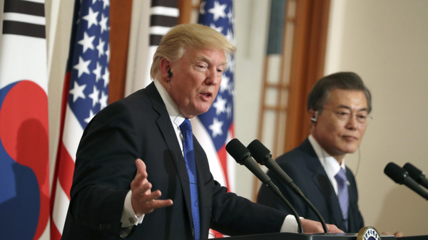 President Donald Trump, left, speaks as South Korean President Moon Jae-in looks on in a joint news conference at the Blue House in Seoul, South Korea, on Tuesday.