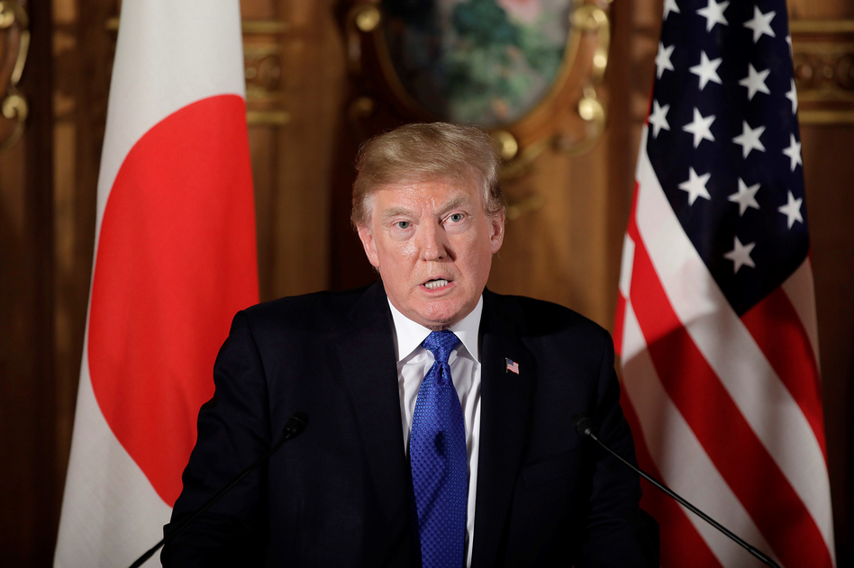 At a press conference in Japan on Monday, President Donald Trump blamed mental illness, not guns, for the Texas massacre. (Anadolu Agency/Getty Images)