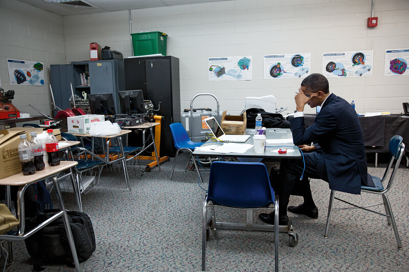 Obama sits alone in a classroom on Dec. 16, 2012, before speaking at the memorial service for victims of the Sandy Hook Elementary School shooting. (Pete Souza/Courtesy of Little, Brown and Company, New York)