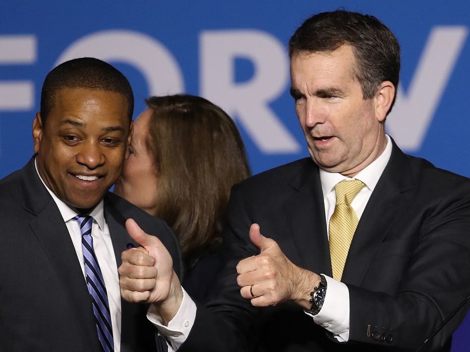 Virginia Gov.-elect Ralph Northam (right) and Lt. Gov.-elect Justin Fairfax greet supporters at an election night rally Tuesday after the Democrats' victory. (Win McNamee/Getty Images)