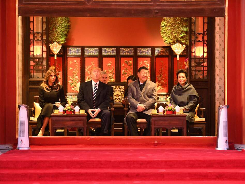 Chinese President Xi Jinping and his wife, Peng Liyuan, hosted President Trump and first lady Melania Trump during a tour of the Forbidden City in Beijing on Wednesday at the start of the third leg of Trump's Asian tour. (Jim Watson/AFP/Getty Images)