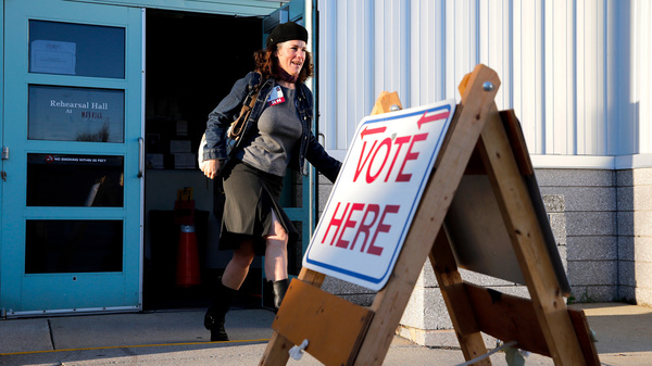 Rosemary Warnock, a registered nurse at Maine Health, exits the Merrill Auditorium voting station in Portland, Maine, early Tuesday. She said she was motivated to vote for Medicaid expansion.