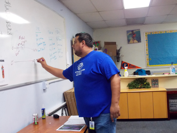 Jeovan Davila leads a discussion about marijuana use and perceptions among students at the Boys & Girls Club of Westminster, Calif.