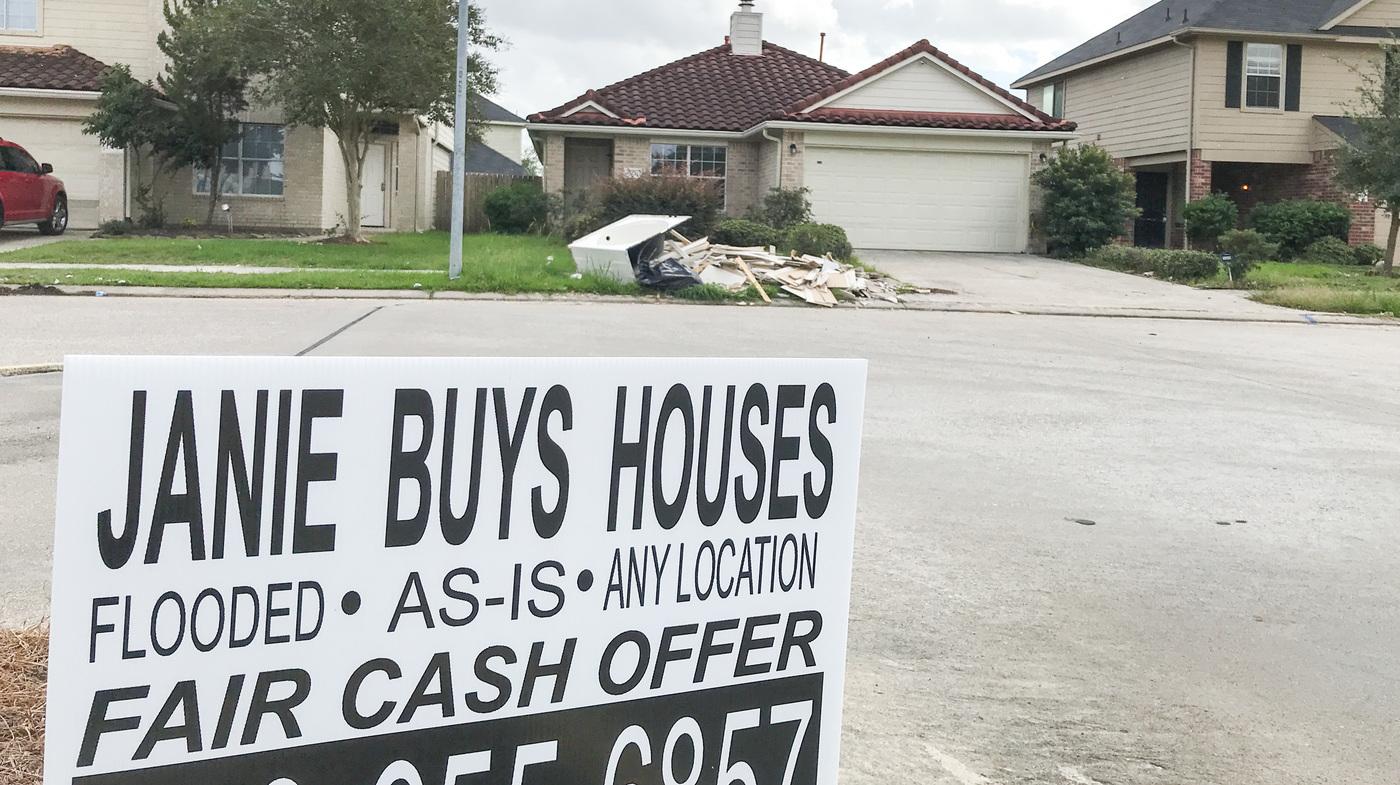 real estate investors rush to buy houston homes damaged