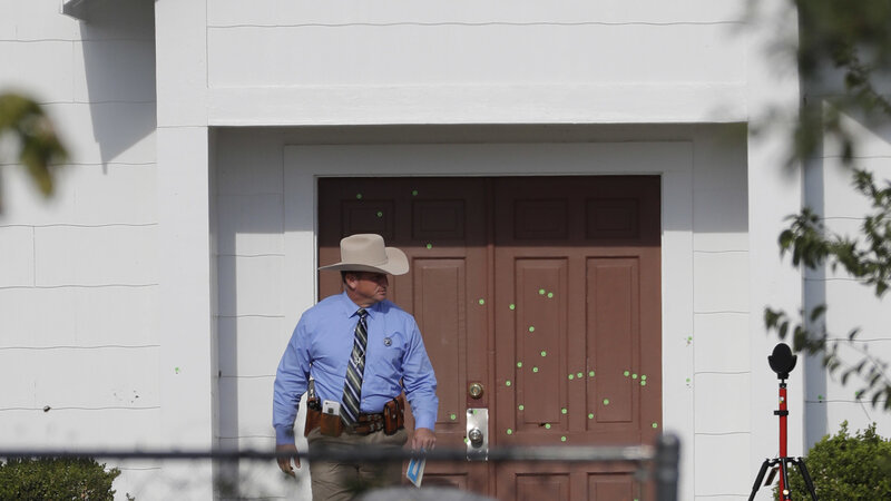 A law enforcement official leaves the First Baptist Church on Tuesday, in Sutherland Springs Texas. (David J. Phillip/AP)