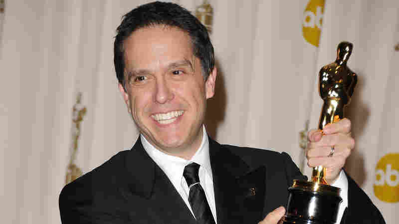 Director Lee Unkrich poses with the Oscar for Toy Story 3 in 2011.