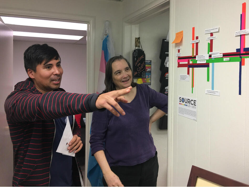 Nick Vargas talks with Dr. Kathryn Hall at The Source, an LGBT center in Visalia, Calif. Hall says that time and time again, her patients tell her they're afraid to come out to their other doctors. (Ezra David Romero/Valley Public Radio )