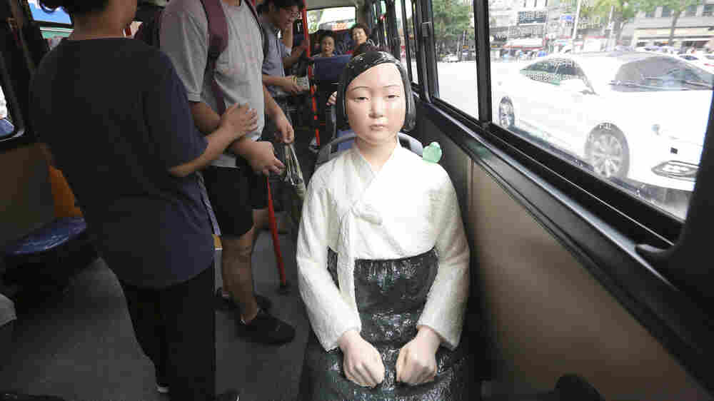 'Comfort Woman' Memorial Statues, A Thorn In Japan's Side, Now Sit On Korean Buses