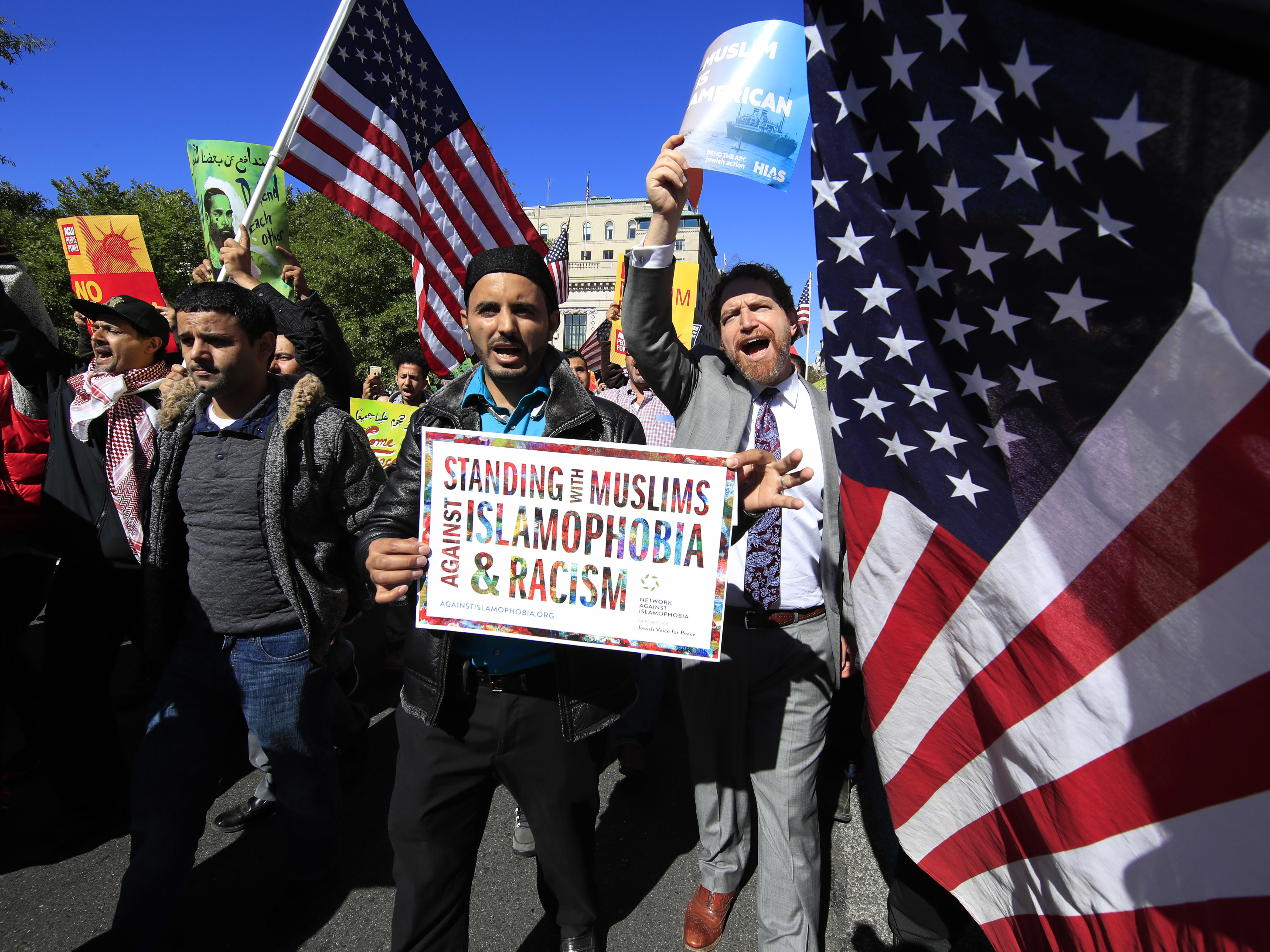 """Muslim and civil rights groups and their supporters gather at a rally against what they call a """"Muslim ban"""" in Washington in October."""