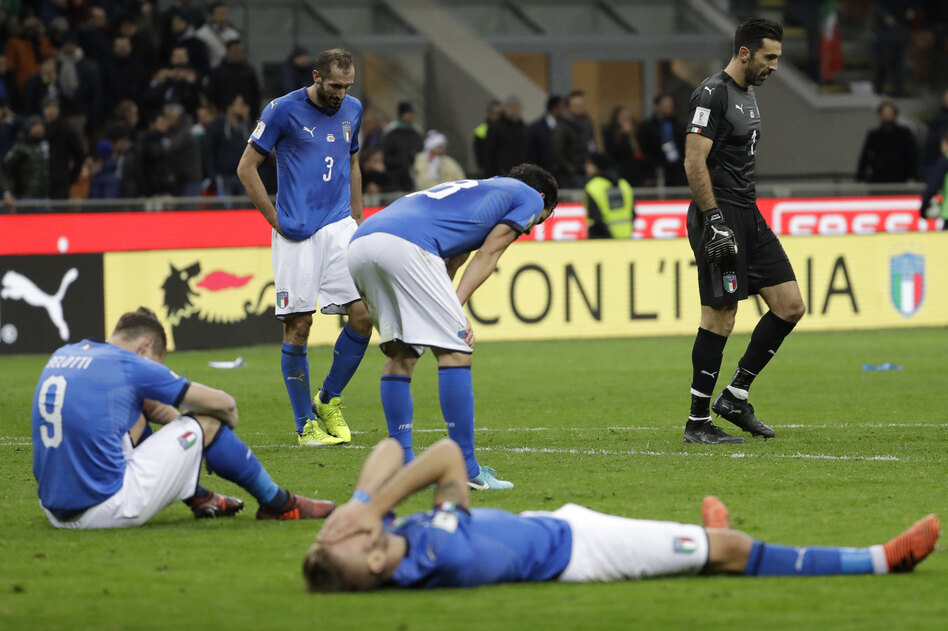 Italian national team players slump in dejection at the end of their World Cup qualifying match against Sweden on Monday. The 0-0 draw killed the four-time world champions' hopes of a spot in the 2018 tournament. (Luca Bruno/AP)
