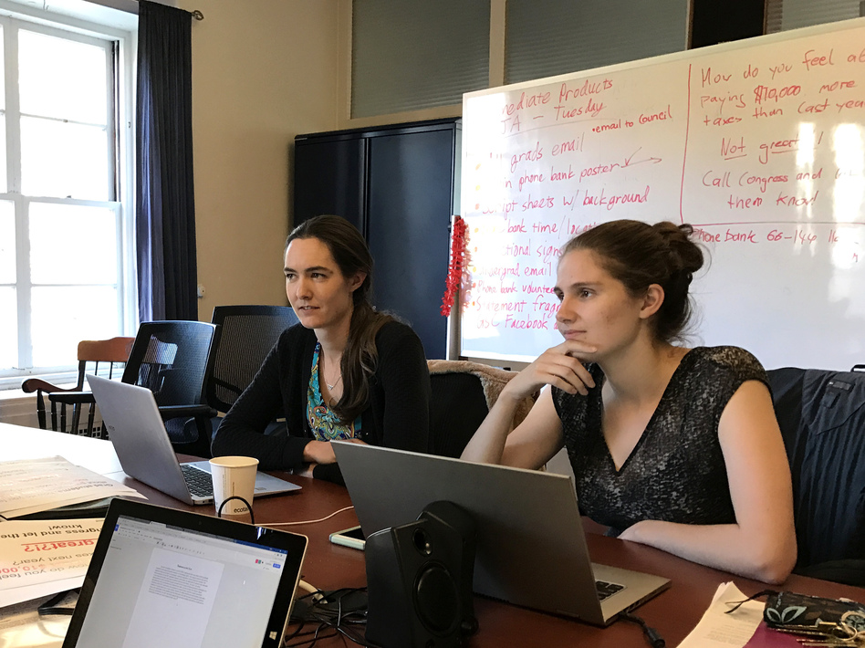 """Students Kate Shulenberger (left) and Sarah Goodman on the Massachusetts Institute of Technology's Graduate Student Council plan a """"call your congressman"""" event on campus. (Chris Arnold/NPR)"""