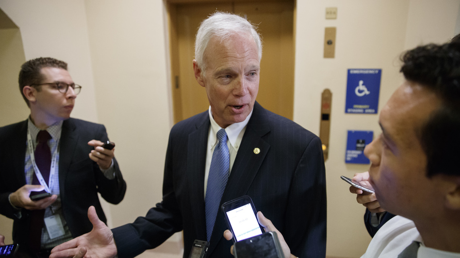 Sen. Ron Johnson, R-Wis., talks to reporters in July. On Wednesday, Johnson became the first GOP senator to come out against the current tax plan. (J. Scott Applewhite/AP)