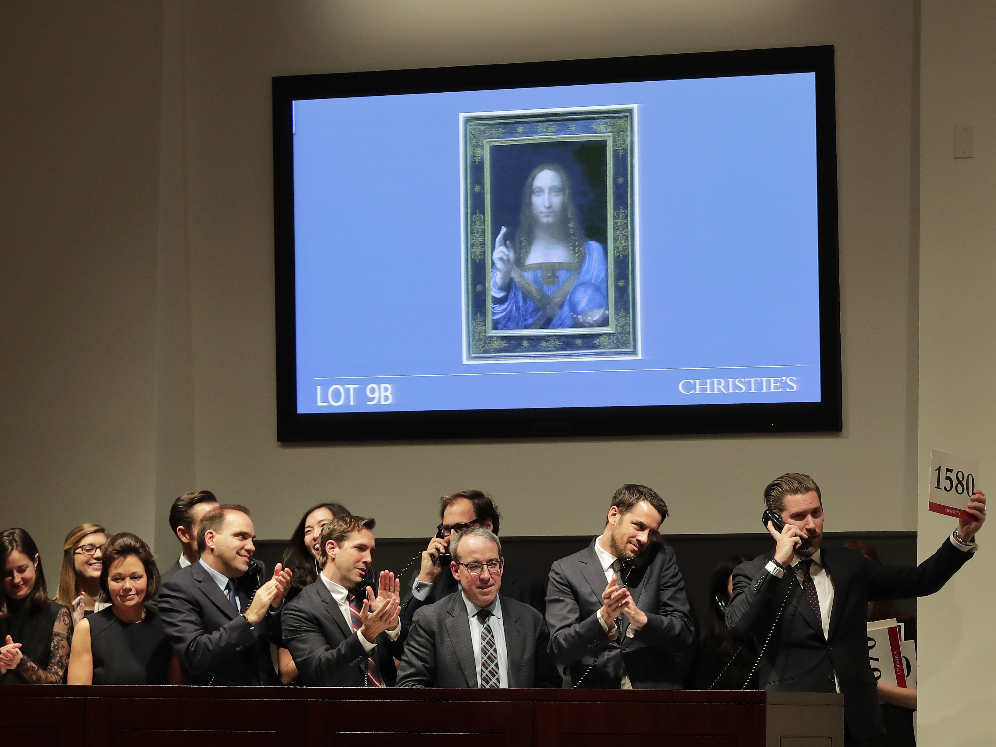 Bidding representatives react after Salvator Mundi sold for $450 million at Christie's on Wednesday