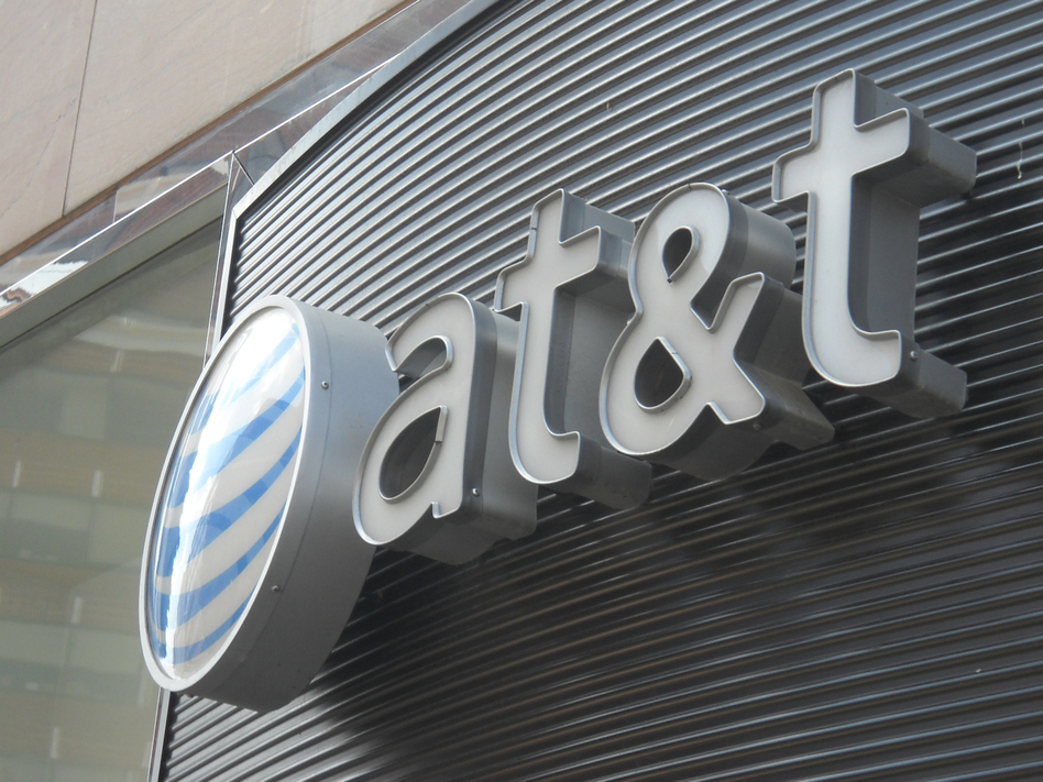 The Trump administration is filing a lawsuit to block AT&T's purchase of a Time Warner, an $85 billion deal. Time Warner is the parent company of CNN, a frequent target of President Trump's ire at the media. (Etienne FRANCHI/AFP/Getty Images)