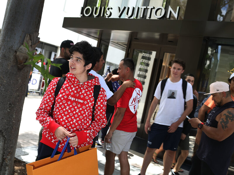 ddd648cce813 Enlarge this image. Mateo Lorente (left) wears his new Supreme shirt as  people flock to a Louis Vuitton ...