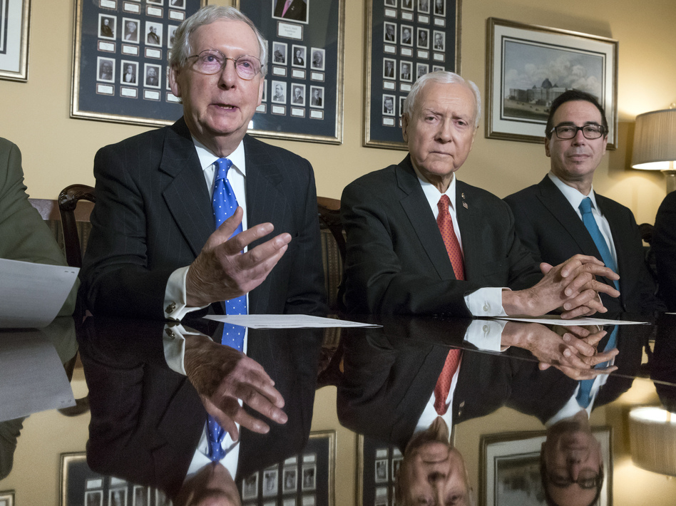 Senate Majority Leader Mitch McConnell, R-Ky., Senate Finance Committee Chairman Orrin Hatch, R-Utah, and Treasury Secretary Steven Mnuchin speak to reporters about the Senate's version of the GOP tax reform bill. (J. Scott Applewhite/AP)