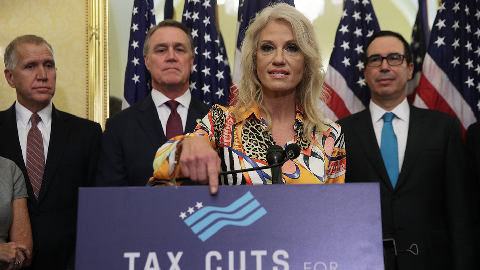 White House counselor Kellyanne Conway speaks at a press conference with (from left) Republican Sens. Thom Tillis and David Perdue, and Treasury Secretary Steve Mnuchin on Nov. 7. Only 2 percent of economists polled thought the GOP tax plan would lead to higher growth. (Alex Wong/Getty Images)