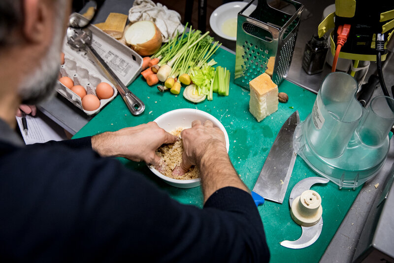Bottura kneads the breadcrumbs with some eggs, nutmeg and grated Parmesan cheese to create a dough for our pasta. (Beck Harlan/NPR)