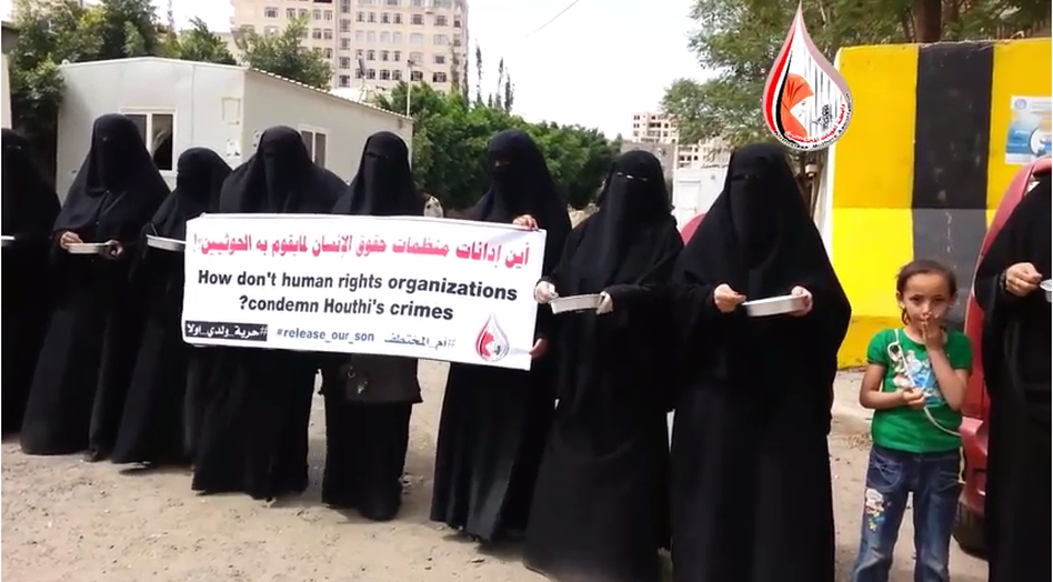 Women in Yemen protest outside the office of the country's High Commissioner for Human rights. ( رابطة أمهات المختطفين/NPR Screenshot)