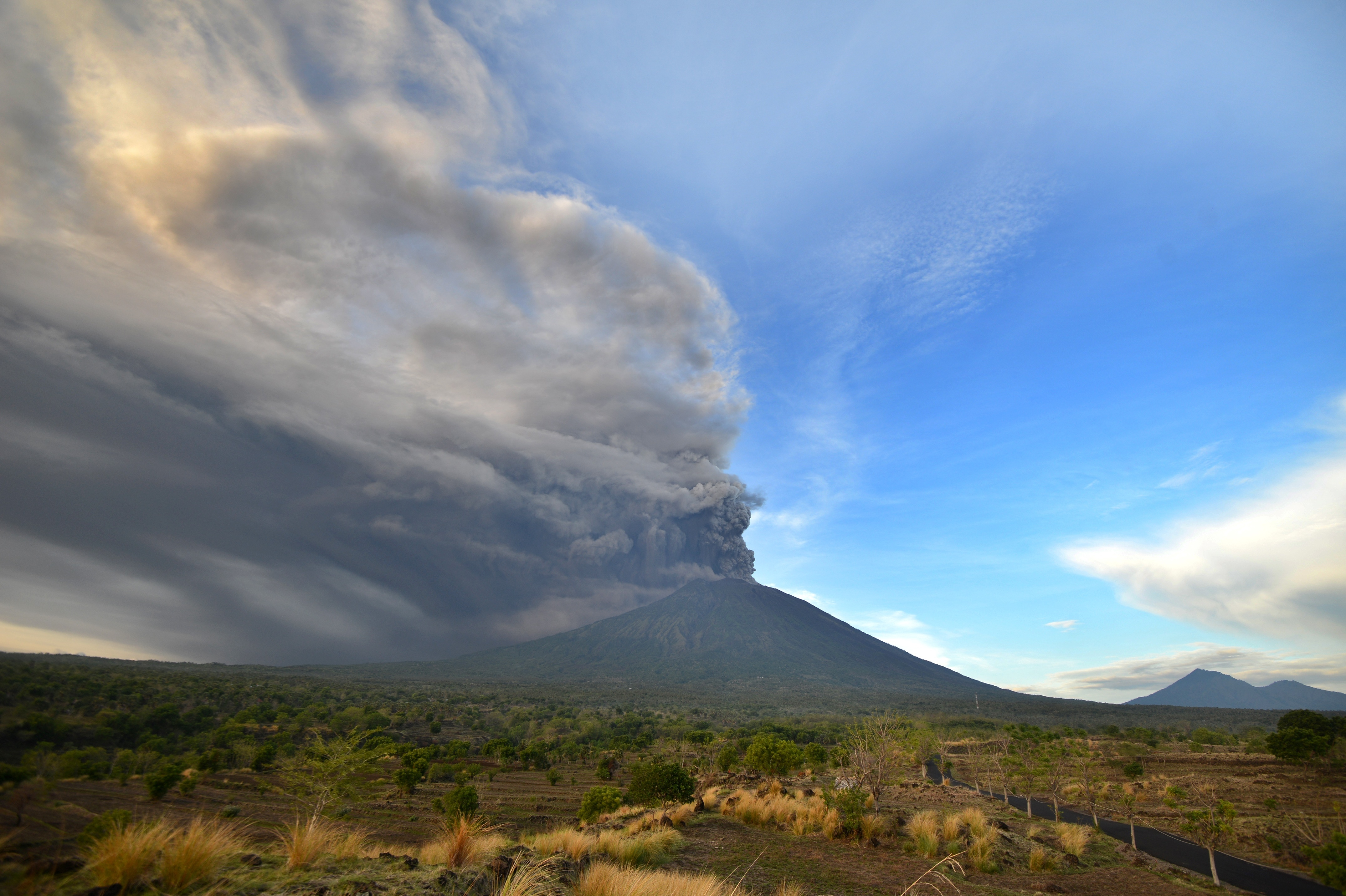 In Bali, a volcano spews smoke, new fears of eruption