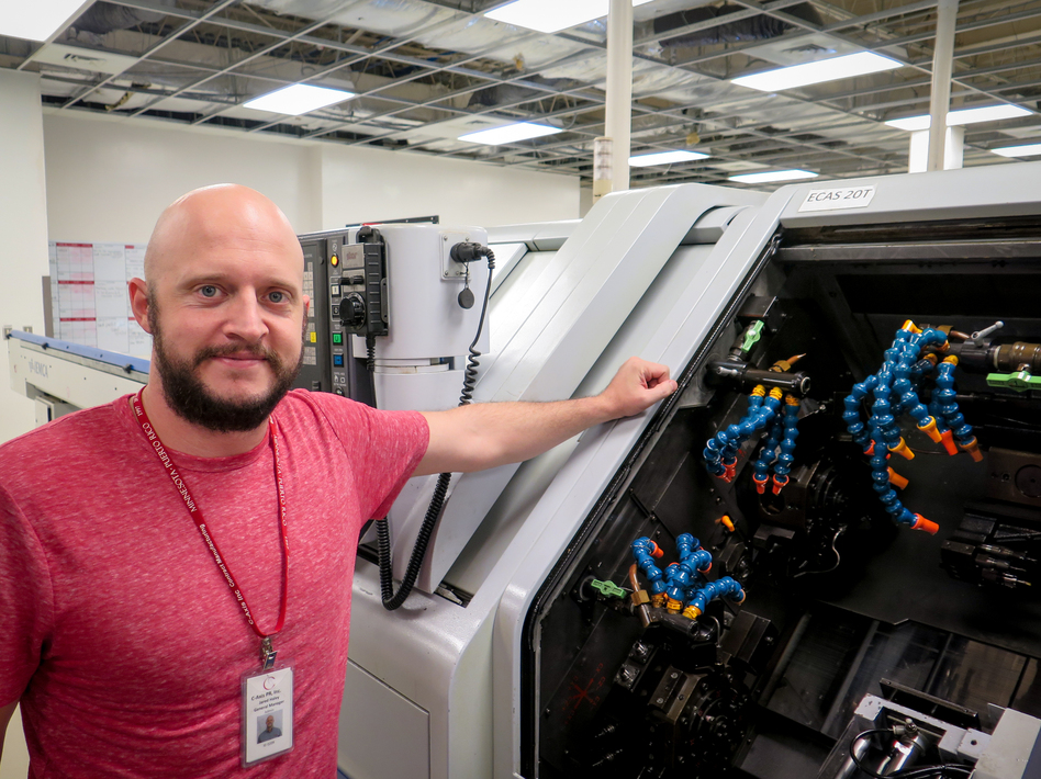 Jared Haley, general manager of the C-Axis plant in Caguas, Puerto Rico, says computer-operated milling machines like this one can cost more than a half-million dollars. Heat and humidity in the plant after Hurricane Maria left many of the machines inoperable, Haley says. (Greg Allen/NPR)