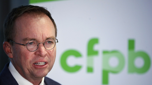 Mick Mulvaney speaks at a news conference after his first day as acting director of the Consumer Financial Protection Bureau on Monday.
