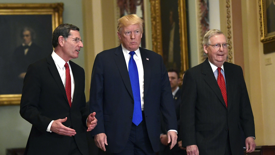President Trump at a Senate GOP lunch with Sen. John Barrasso, R-Wyo. (left), and Senate Majority Leader Mitch McConnell, R-Ky., on Tuesday, where he talked with several holdouts on the tax bill about measures to bring them on board. (Susan Walsh/AP)