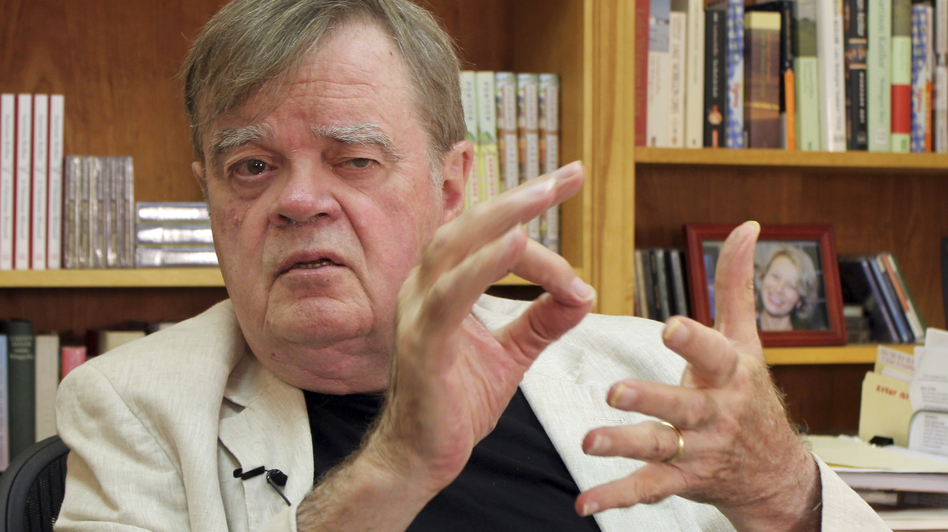 Garrison Keillor, creator and former host of <em>A Prairie Home Companion,</em> talks at his St. Paul, Minn., office in July. Minnesota Public Radio has announced it is cutting ties with Keillor and his production company owing to allegations of inappropriate behavior. (Jeff Baenen/AP)