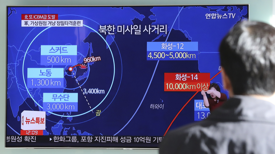 A man in Seoul, South Korea, watches a local news report about North Korea's missile launch on Wednesday. (Lee Jin-man/AP)