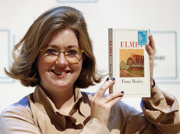 Author Fiona Mozley poses with her book Elmet.