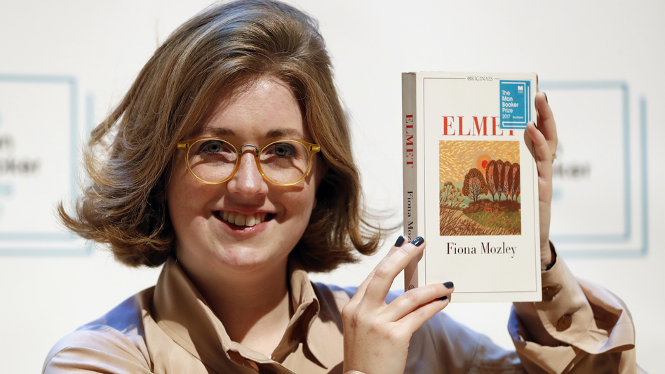 Author Fiona Mozley poses with her book <em>Elmet</em>.
