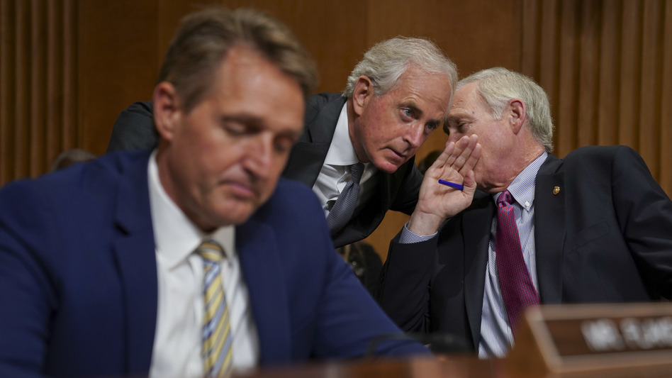 Sens. Jeff Flake, R-Ariz., Bob Corker, R-Tenn., and Ron Johnson, R-Wis., seen at a hearing earlier this month, held up floor action on Thursday evening over concerns about how to control the deficit if the GOP tax bill doesn't result in strong economic growth. (Pablo Martinez Monsivais/AP)