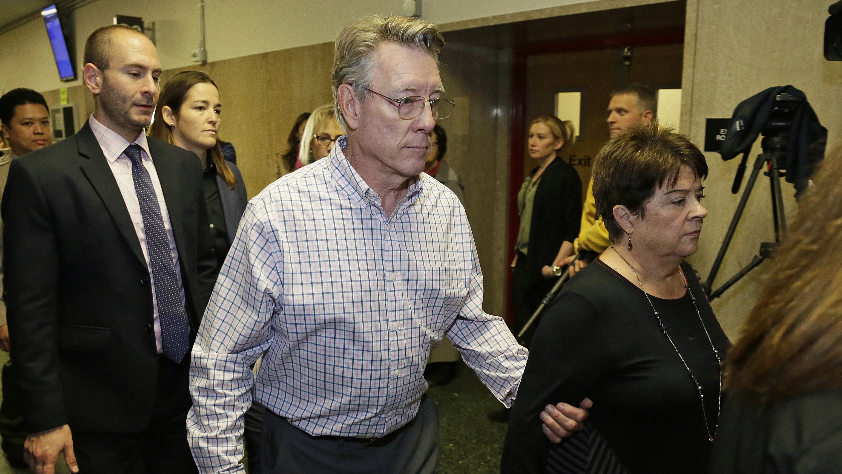Kate Steinle's parents Jim Steinle and Liz Sullivan walk to a courtroom for closing arguments in the trial on Nov. 20