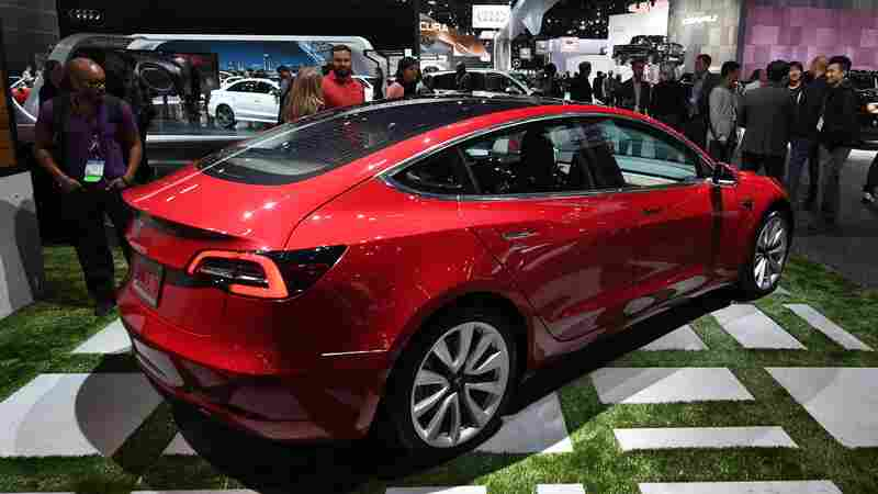 Tesla Going At 'Warp Speed,' But Lags In Race To Produce Mass Market Electric Cars