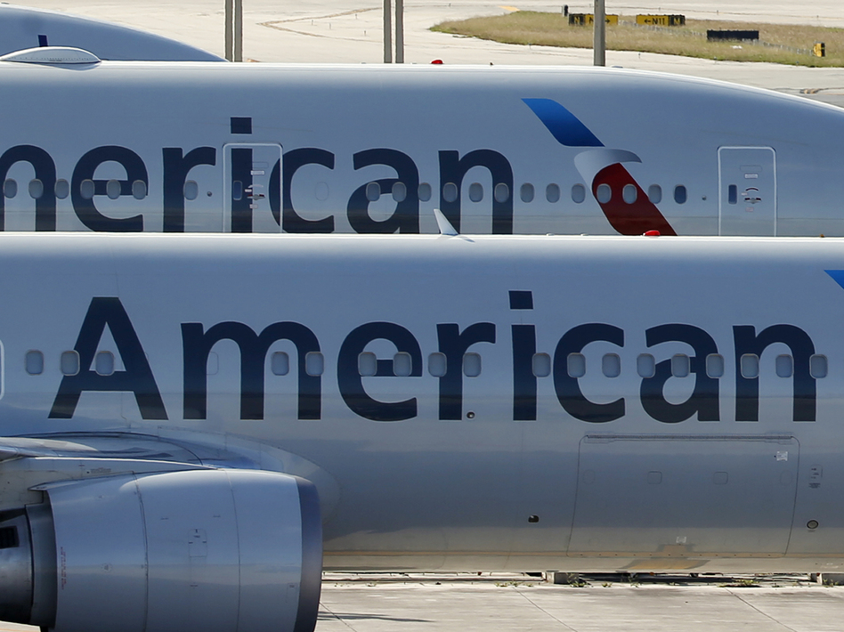 American Airlines has a deal with its pilots to keep its end-of-the-year flights staffed. The airline had inadvertently given too many pilots the holidays off. (Wilfredo Lee/AP)